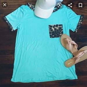 Turquoise tee size small.